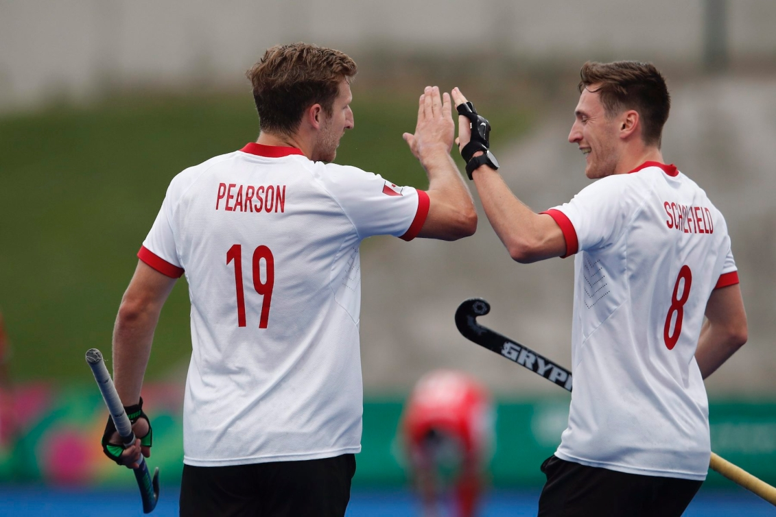 Canada's Mark Pearson, left, is congratulated by teammate Oliver Scholfield, after scoring against Mexico during a men's field hockey match at the Pan American Games in Lima, Peru, Tuesday, July 30, 2019. (AP Photo/Moises Castillo)