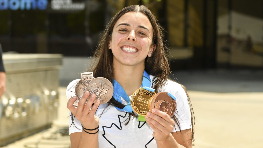 Meaghan Benfeito holds her replacement Olympic and Pan Am Games medals