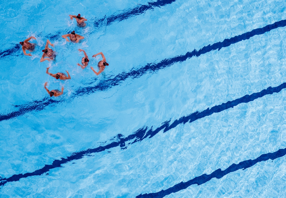 artistic swimmers performing in the water