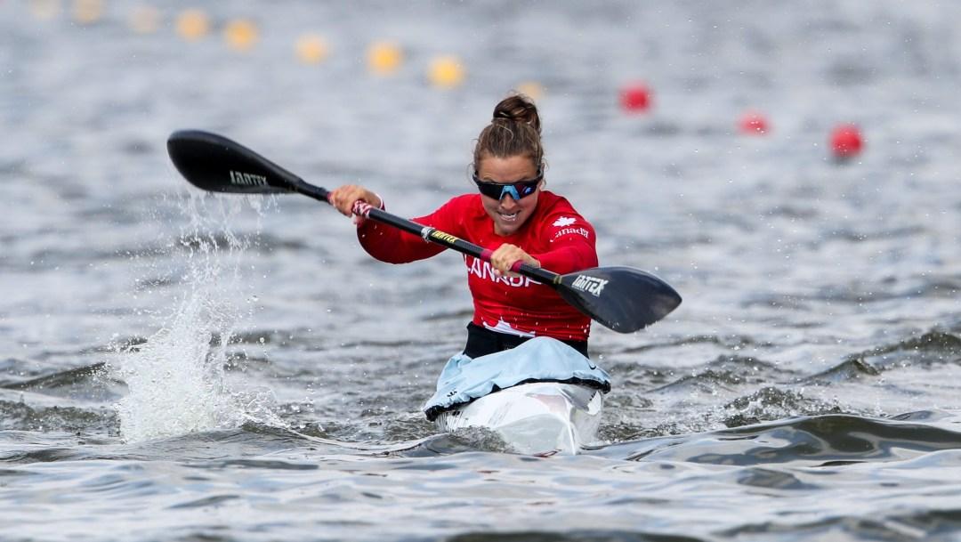Female kayaker racing