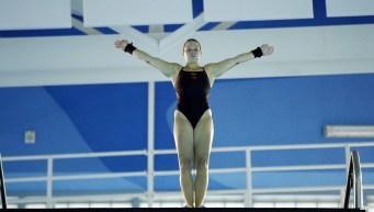 Diver stands on 10m platform