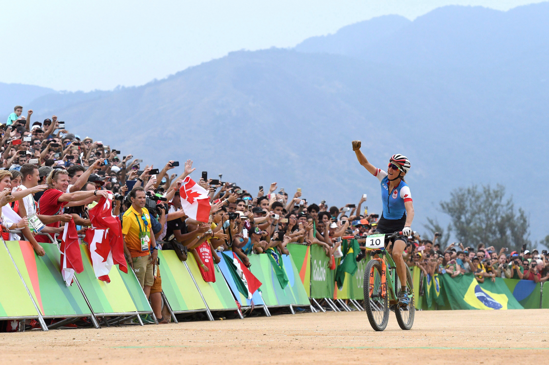 cyclist crosses finish line