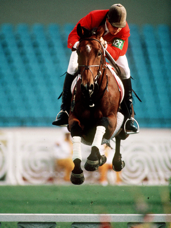 Canada's Mario Deslauriers rides horse at Olympics
