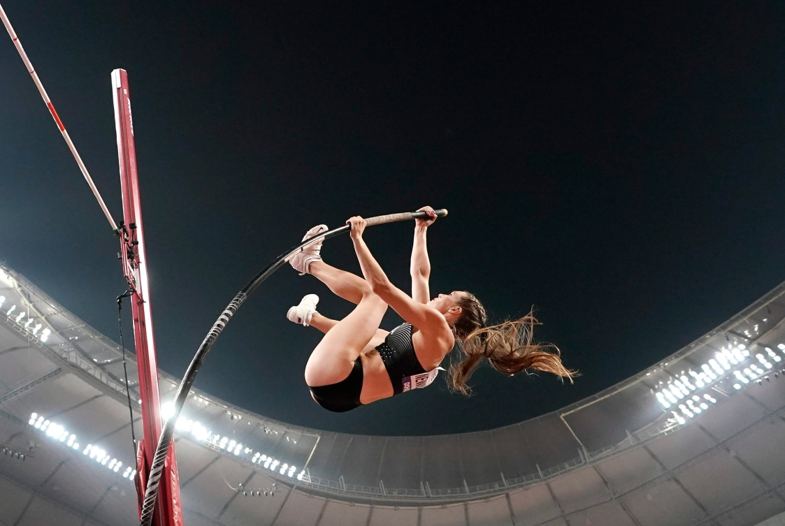 Pole vaulter going over the bar