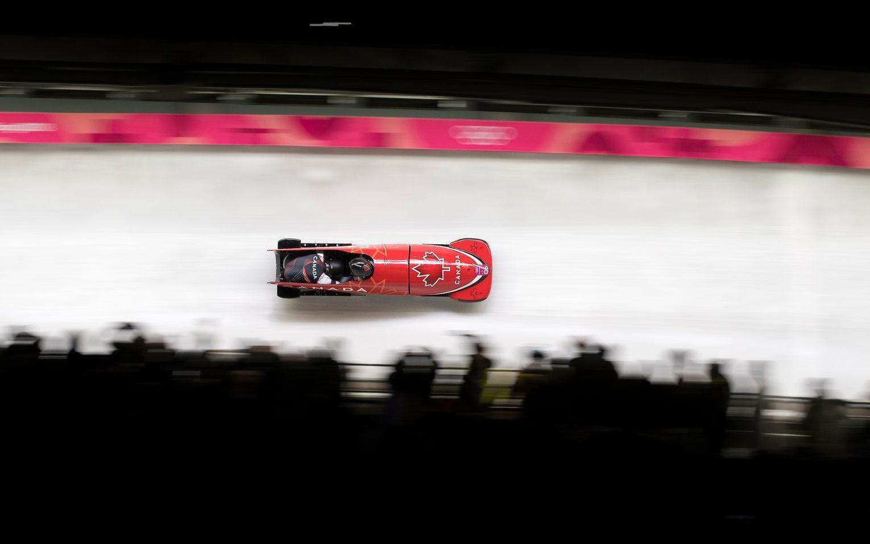 Canada's Justin Kripps et Alex Kopacz lors de la troisième manche de l'épreuve masculine de bob à deux des Jeux olympiques de PyeongChang, le 19 février 2018.